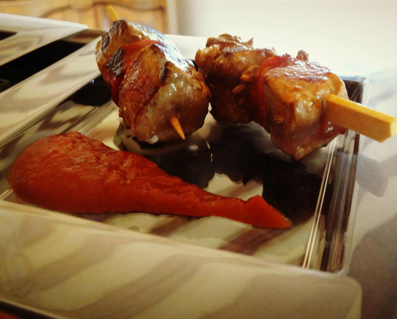 tuna and chorizo skewers on a plate